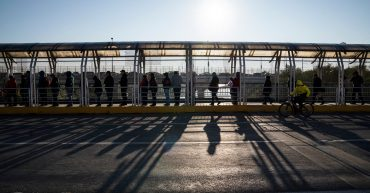 People wait in the McAllen-Hidalgo-Reynosa International Bridge to cross to the United States on Dec. 10, 2018. Verónica G. Cárdenas for Rolling Stone