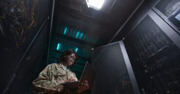 Military Network Technician Inspecting Sever