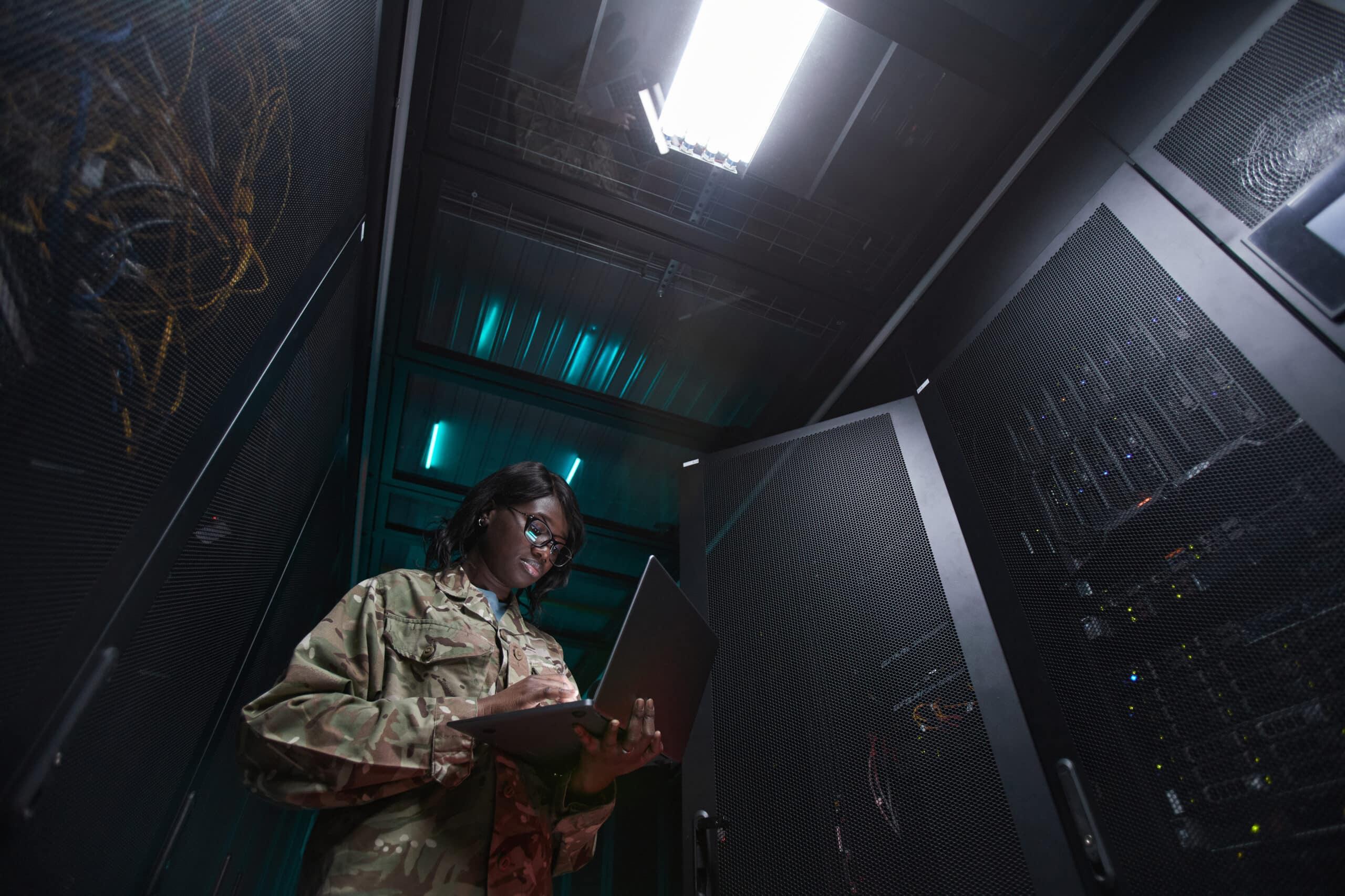 Military Network Technician Inspecting Server