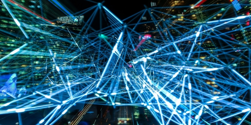 night image of network of lights with buildings in the background Settlements Exports Controlled - Software Encryption