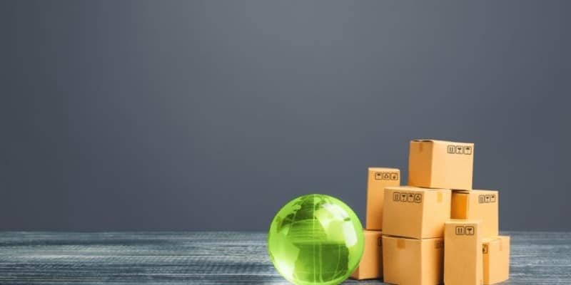 stack of boxes with clear green globe next to them